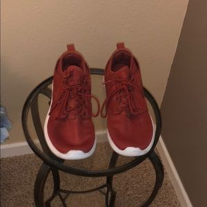 Red and white Nike light weight running shoes